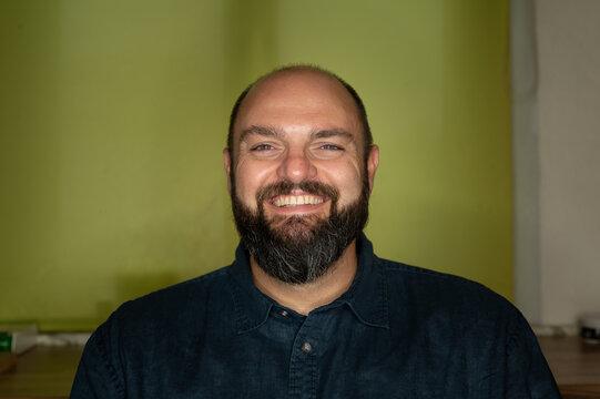 Man smiles friendly at the camera