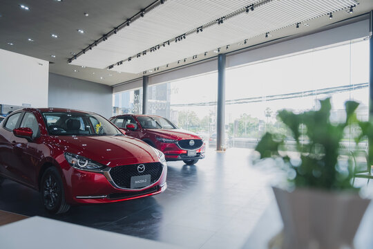 BANGSAEN,THAILAND 2020, car all new MAZDA3 MAZDA2 2020 brand japan red  color on room customer dealership in garage parked in showroom of thailand for transport Illustrative editorial image