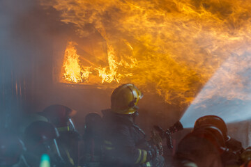 Firefighters battled the raging fire with large flames that burned down residential buildings.