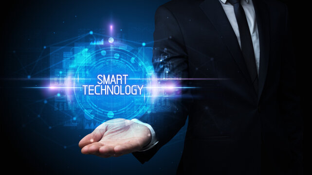 Man hand holding SMART TECHNOLOGY inscription, technology concept