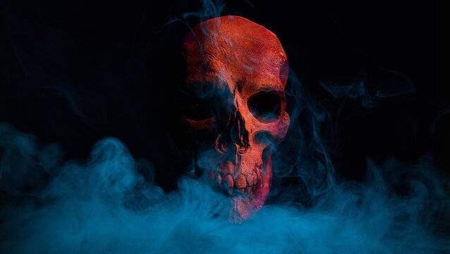 Scary grunge red skull wallpaper. Mystical smoke background with free space for text.