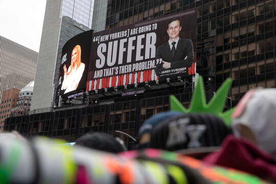 Images of Ivanka Trump and Jared Kushner are seen alongside messages about coronavirus disease in New York