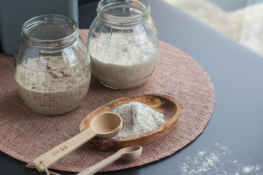 100% natural organic sourdough starters: freshly fermented rye and wheat starters in glass jars ready to use to make sourdough bread