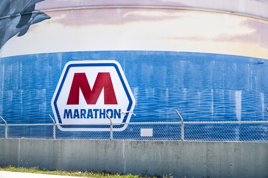 Tampa, USA - April 27, 2018: Florida town with building exterior industrial oil tanker for Marathon Petroleum Corporation at terminal with sign and logo