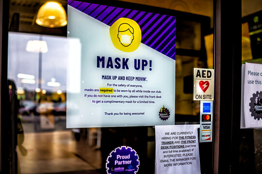 Sterling, USA - September 9, 2020: Planet fitness gym entrance sign for mask up requirement now open during coronavirus in Virginia with nobody