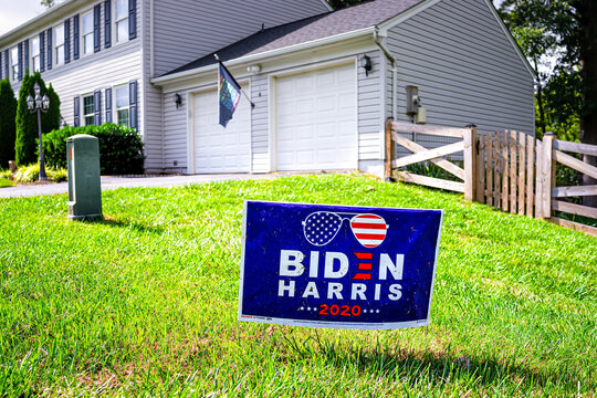 Sterling, USA - September 15, 2020: Closeup of presidential election political yard lawn sign poster for Joe Biden Harris 2020 in northern Virginia suburbs with brick house exterior