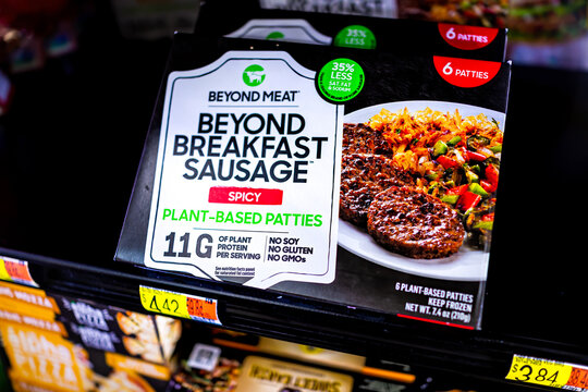 Sterling, USA - September 28, 2020: Closeup of spicy Beyond Meat breakfast sausages plant-based patties on retail shelf freezer at Walmart grocery supermarket with 35% less saturated fat and sodium