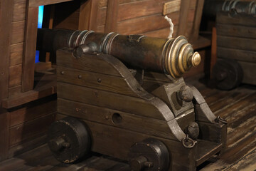 old cannon in wooden ship