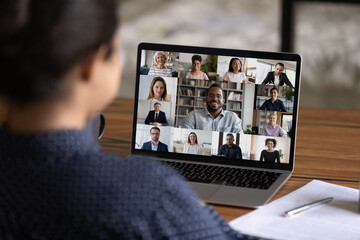 Photo sur Plexiglas Dinosaurs Over shoulder view of female worker have webcam digital virtual conference with diverse multiethnic colleagues. Woman speak talk on video call with multiracial businesspeople. Online meeting concept.