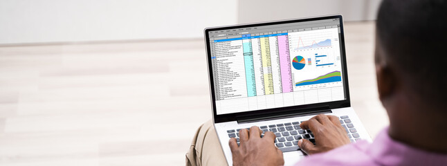 African American Man Using Spreadsheet Reports
