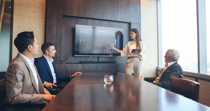 Executive business people wear suit have meeting and talking and discussing in conference room, leader present result and idea to the team by using tablet and document
