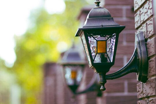 Old vintage glass retro lantern on a brick post
