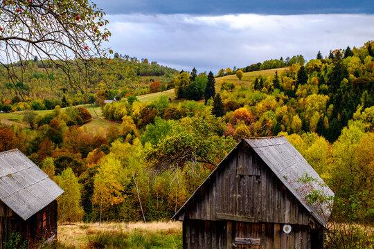 Colorful autumn landscape in the Romanian Carpathians, Fantanele village, Sibiu county, Cindrel mountains, 1100m, Romania