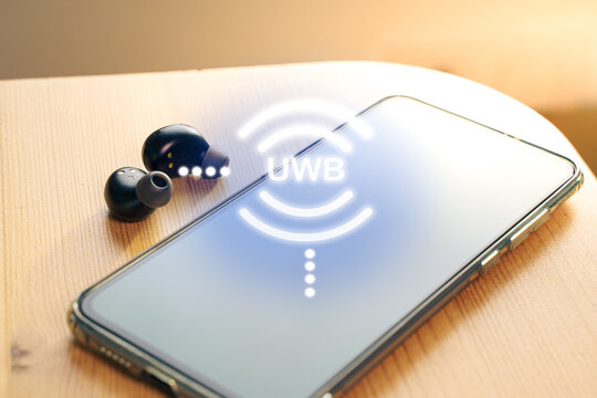 UWB or ultra wireband radio technology Wireless earphones connecting to a smartphone