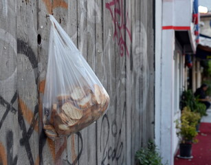Wall Murals Ass A bag of old bread for the poor hangs on a fence on Abdul Ezel Pasha street in Istanbul. Turkey