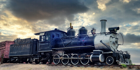 Blue antique railroad train engine on tracks