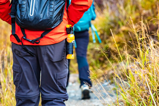 Bear spray self-defence attached to backpackers when hiking