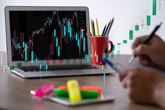 man Analyzing data graphs and reports investor with computer and tradeview graph Finance Stock Exchange finance traders