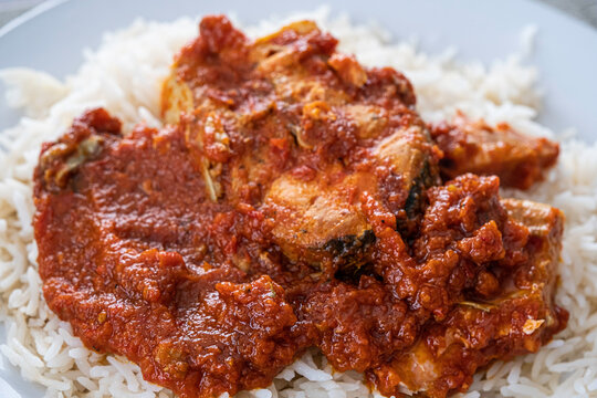 Nigerian Fish tomato pepper sauce with rice ready to eat