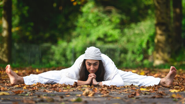Yoga posture on the ground on the autumn leaves
