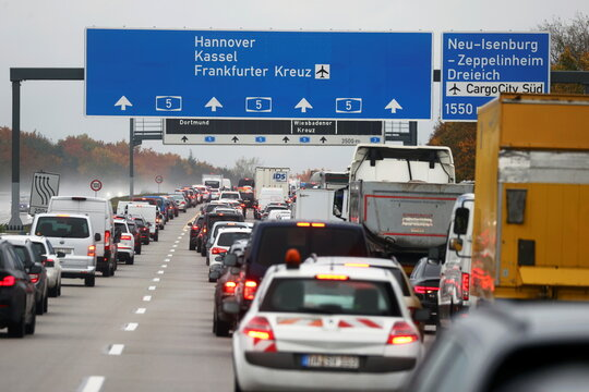 Activists hang on a bridge of A5 highway near Frankfurt causing traffic jams