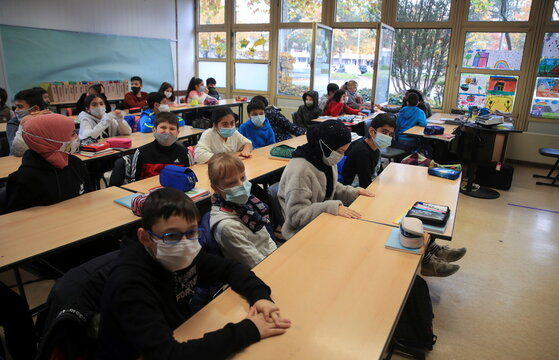 School resumes with open windows and protective masks against spread of coronavirus disease in Bonn