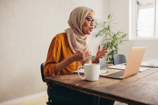 Muslim business woman on a zoom video call