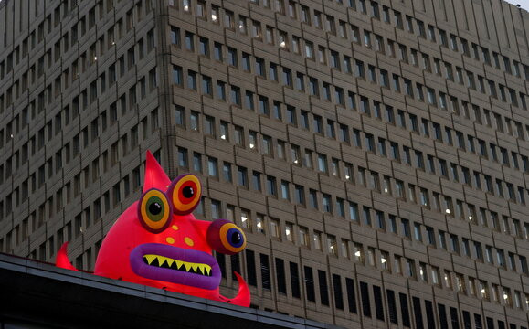 A giant inflatable monster, one of a collection of monsters that have appeared to mark Halloween is seen in front of an office block in Manchester