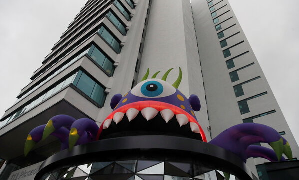 A giant inflatable monster, one of a collection of monsters that have appeared to mark Halloween, is seen on the roof of an office block in Manchester