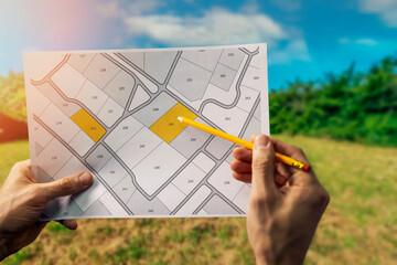 Fototapeta sale of building plot of land for house construction. cadastral map on field background