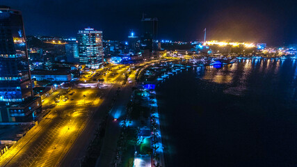 Road, lights and sea at night. Luanda city captured from the top Fotomurales