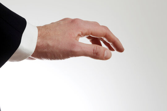 Male hand turned down in front of white background