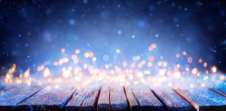 Snowy Wooden Table With Defocused Lights - Abstract Christmas Background