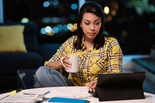 Latin American Woman Working from Home At Night