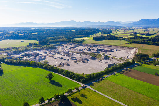 Germany, Bavaria, Huglfing, Drone view of gravel quarry in Alpine foothills during spring