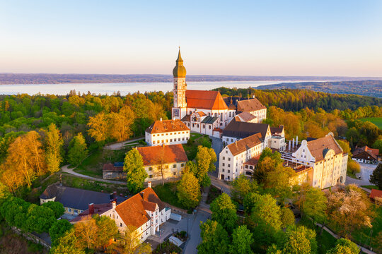Germany, Bavaria, Andechs, Drone view of Andechs Abbey and surrounding buildings at dusk