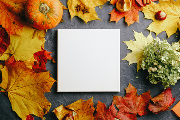 Blank square canvas on autumn background. Mockup poster with colourful autumn leaves. Top view.