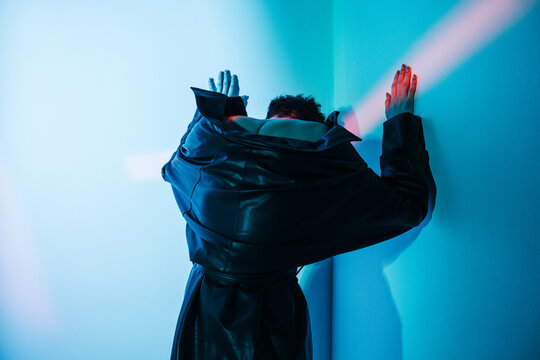 Cyberpunk woman standing under red illumination