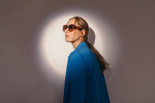 Stylish model under spot of light