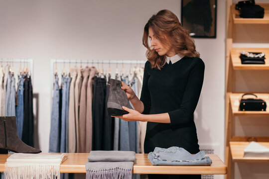 Customer choosing outfit in store