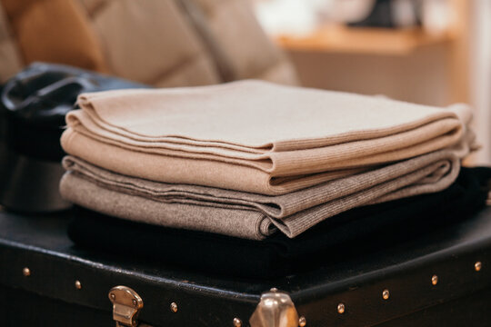 Stack of beige wooden clothes