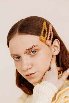 Young model with stylish hair clips