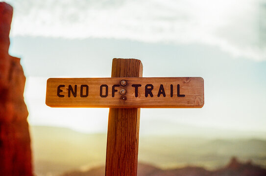 An end of trail sign hiking in the desert