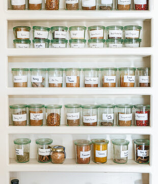 Beautiful spice shelf with jar of label spices