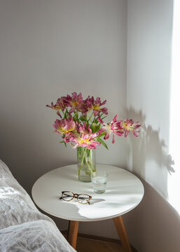 Bed side table with flowers in a vase
