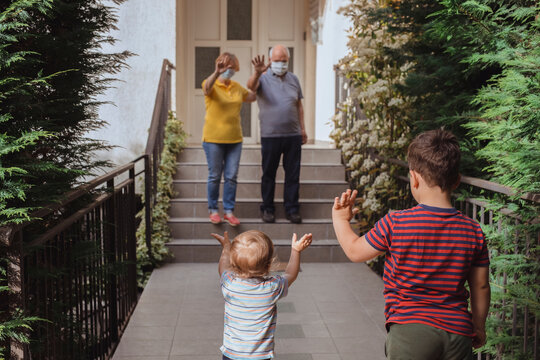 Grandparents waving with their grandsons