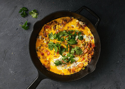 Indian masala omlette in cast iron pan