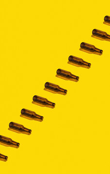 Beer Bottles On Yellow Background