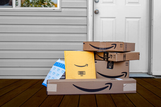 Calgary, Alberta, Canada. Oct 4, 2020. Amazon deliver boxes and envelopes at a home entrance just delivered.