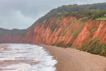 Fototapeta Landscape of the Jurassic Coast (Dorset and East Devon Coast) in rainy and fogy weather, at Sidmouth, Devon, England, UK, a UNESCO World Heritage site.